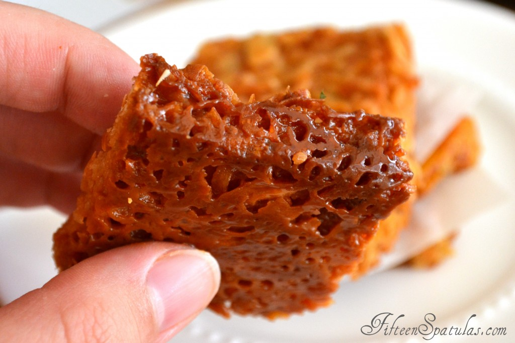 A close up of a piece of Coconut Almond Bark with Caramelized Dulce de Leche