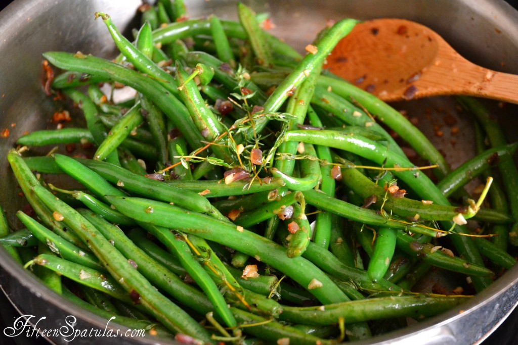 Thanksgiving Green Beans - In Stainless Steel Skillet with Thyme and Wooden Spoon