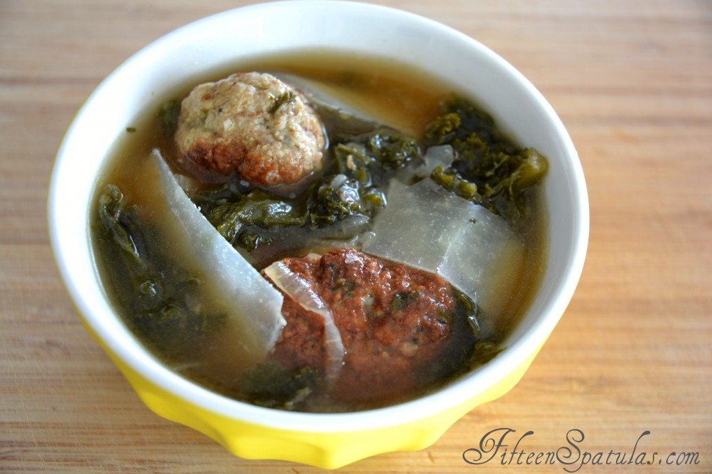 Meatball Soup - In Yellow Bowl with Kale and Pecorino Shavings