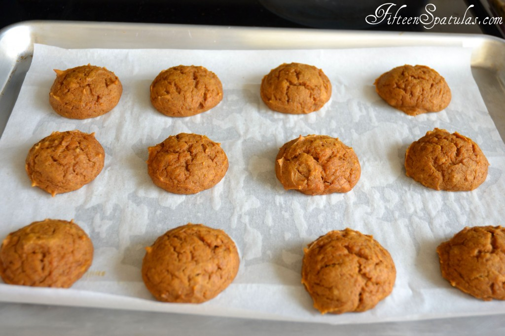 Baked Pumpkin Whoopie Pies on Parchment Paper in Rows