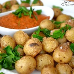 Roasted Baby Potatoes - on White Dish with Romesco Dip in Ramekin and Parsley Sprinkled on Top