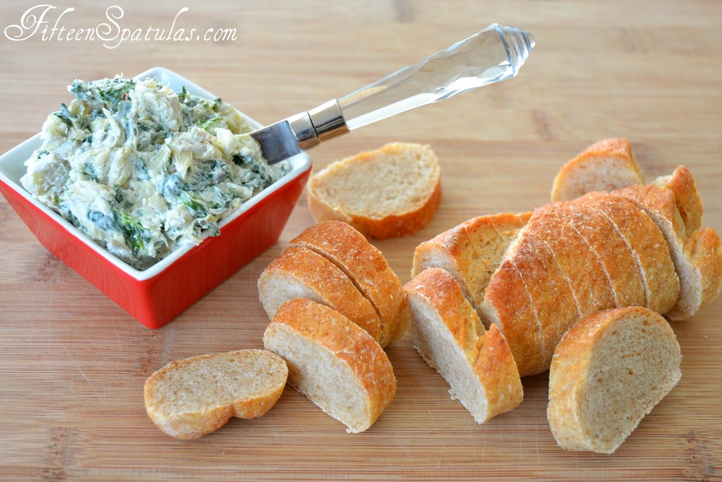 Spinach Artichoke Spread - In Red Dish with Sliced Spread Alongside