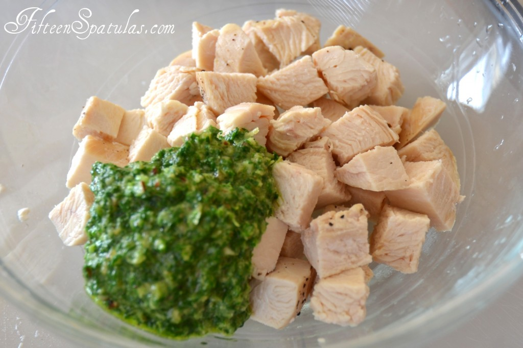 Chicken Chunks with Pesto Mixture in Glass Bowl