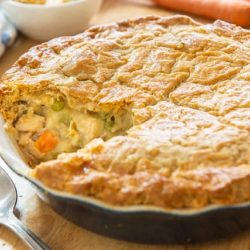 Chicken Pot Pie with a Piece Taken To Show Vegetable Chicken Filling