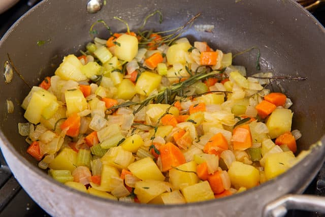Cooked Chopped Carrot, Celery, Onion, and Potato In Pot with Herbs