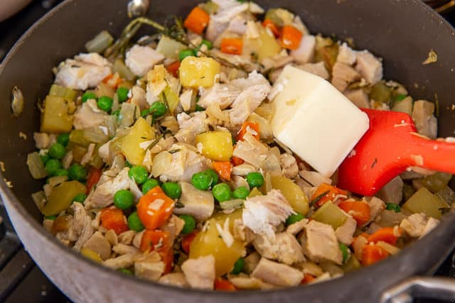 Butter Added to Pot of Vegetables and Chicken