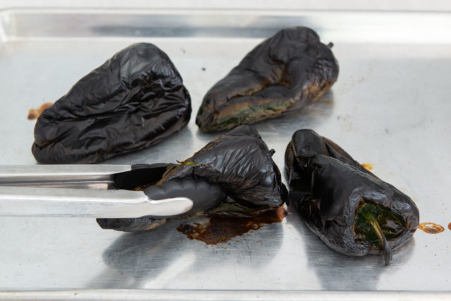 Four Poblano Chile Peppers on a Sheet Pan Blackened