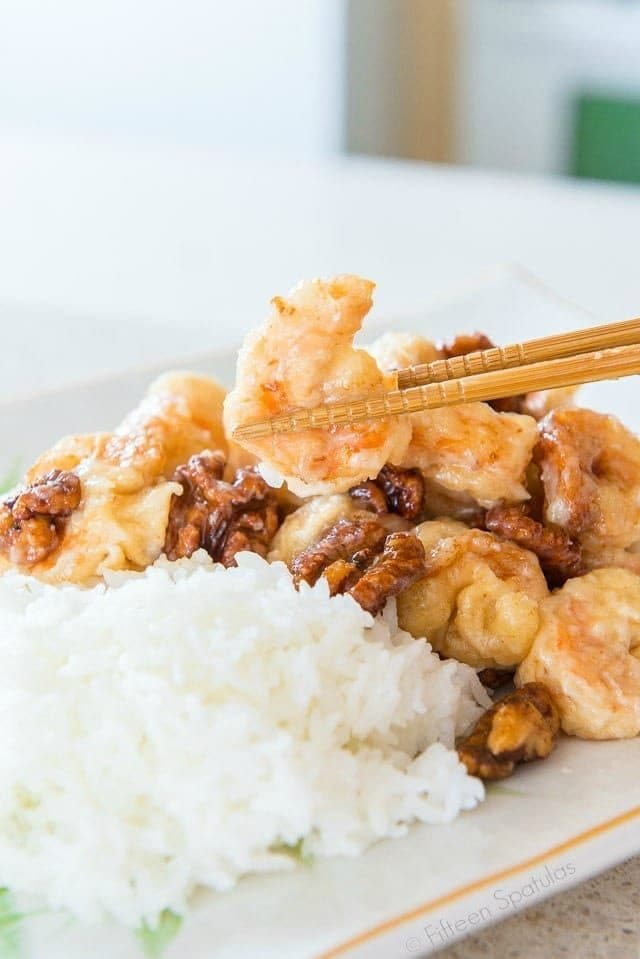 This Honey Walnut Shrimp is easy to make, and so much better than takeout! Shrimp are coated in a puffy egg white cornstarch batter and fried until golden, then tossed in a creamy sweet sauce and caramelized honey walnuts.