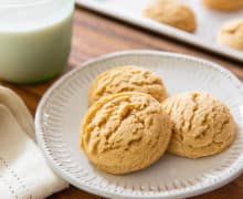 Peanut Butter Cookie Recipe - Presented on White Dish with milk in background