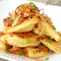 Pile of Fried Pierogies with Onions and Scallion
