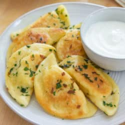 Pierogies on a Plate with Sour Cream