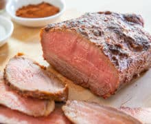 Tri Tip Sliced on a Cutting Board with Spices