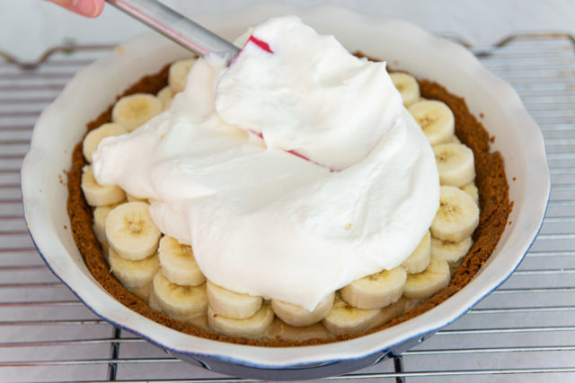 Spreading Whipped Cream On Top of the Banana Slices