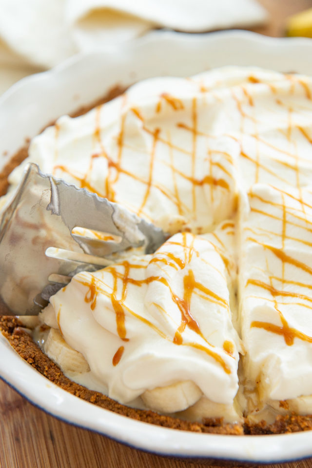 Banoffee Pie - In a Pie Plate with a Slice Being Cut with a Pie Server