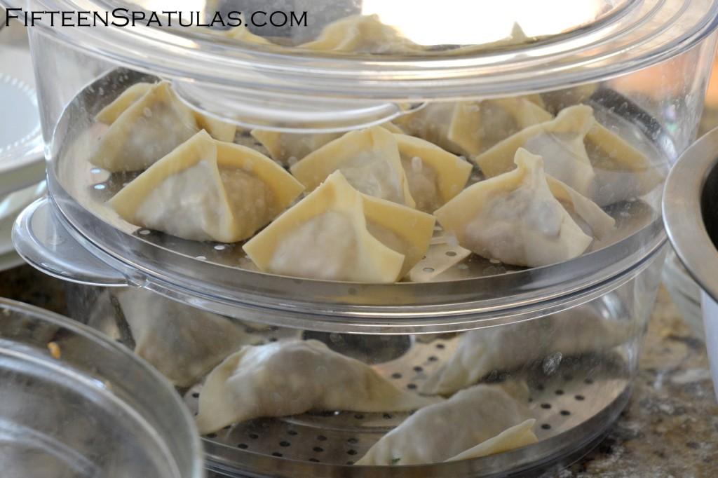 Stacked Trays of Dumplings in Steamer Basket for How to Make Asian Dumplings
