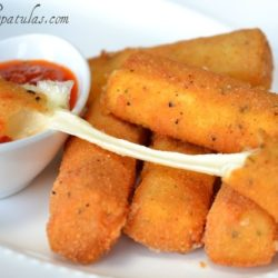 Mozzarella Sticks on White Dish with Marinara Dipping Sauce