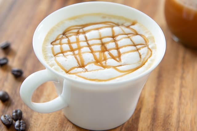 Caramel Macchiato in White Cup with Drizzle