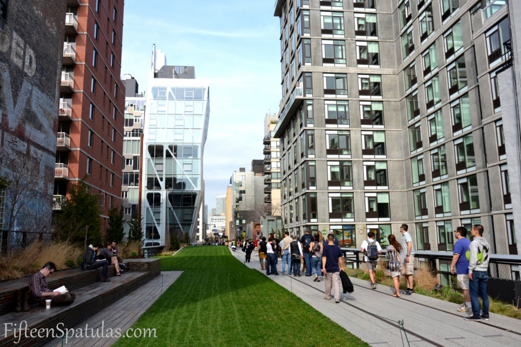 A group of people walking on the highline in NYC