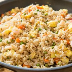 Fried Rice In a Nonstick Skillet with Egg, Carrots, and Peas