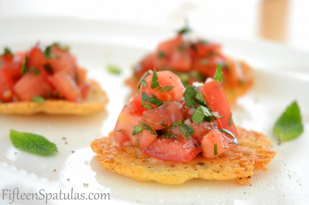 Tomato Salad on Cheese Tuile Crisps on White Platter