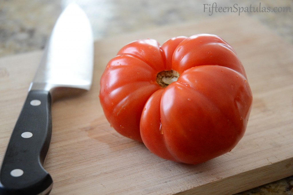 Red Heirloom Tomato on Cutting Board