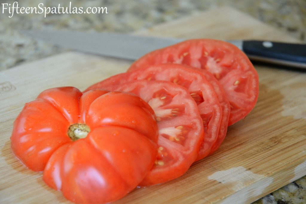Sliced Heirloom Tomato on cutting board