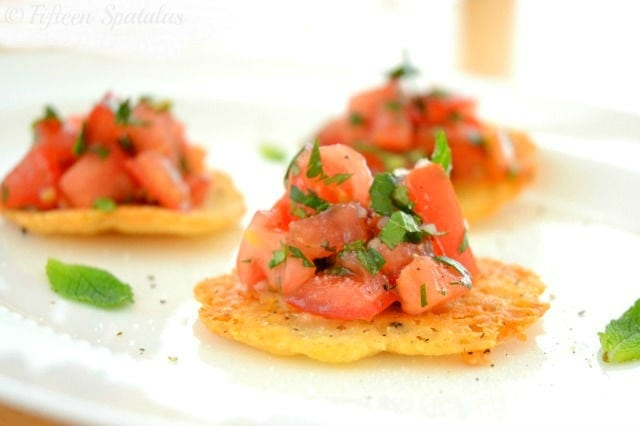 Cheese Tuile Appetizer Bites with Tomato Salad on Top