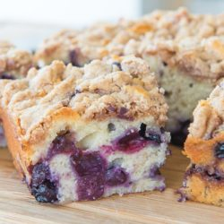 Squares of Blueberry Buckle Cake on a Wooden Board