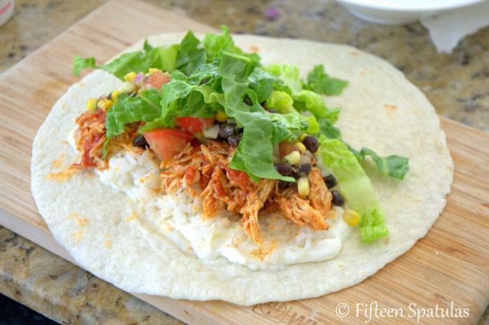 Shredded Chicken Burrito with Flour Tortilla, lettuce, and toppings