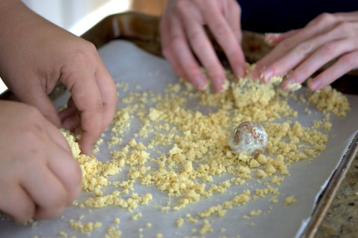 Rolling the Carrot Cake Balls in the Milk Bar Crumbs to Coat