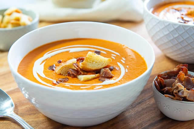 Tomato Bisque Recipe - Served in White bowl with Crouton and Bacon Garnish
