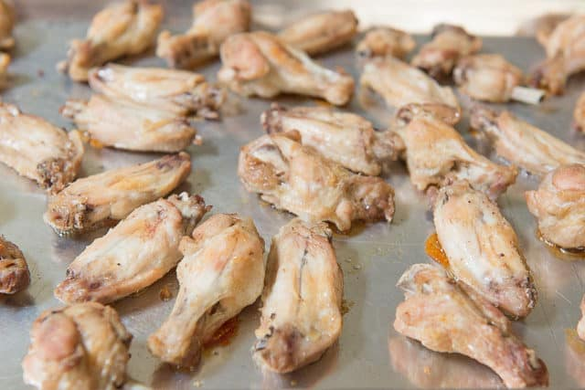 Partially Cooked Baked Wings on Sheet Pan