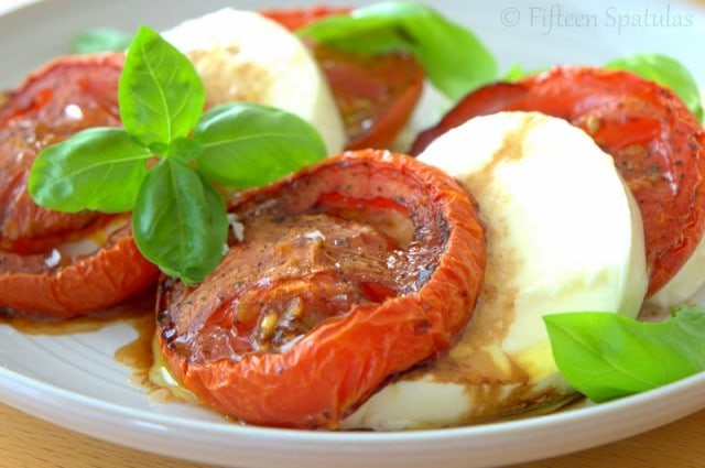 Caprese Salad with Roasted Tomatoes and Basil Arranged on Plate