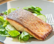 Crispy Skin Salmon - On a Plate with Greens and a Fork