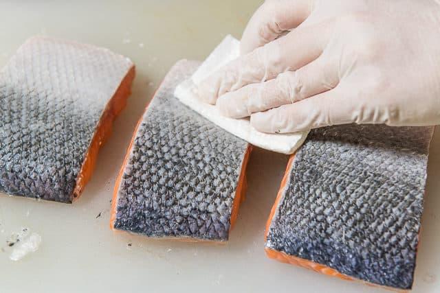 Patting the Salmon Skin Dry So It Fries Up Crispy