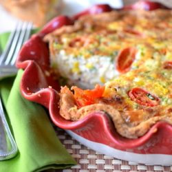Bacon Corn Tomato Quiche with Slice Removed to Show Filling