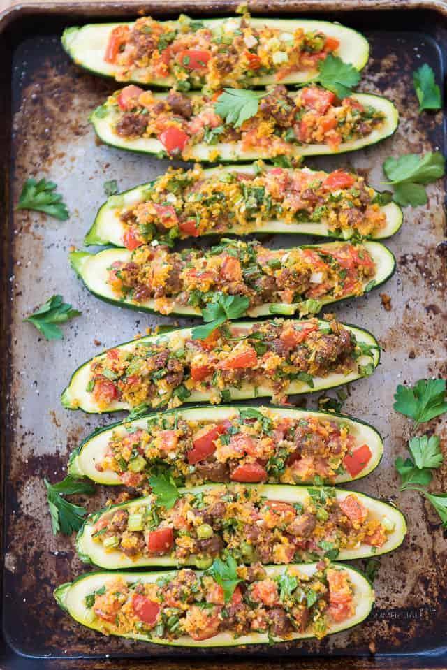 Sausage Stuffed Zucchini - Lined Up In a Single Layer on a Sheet Pan