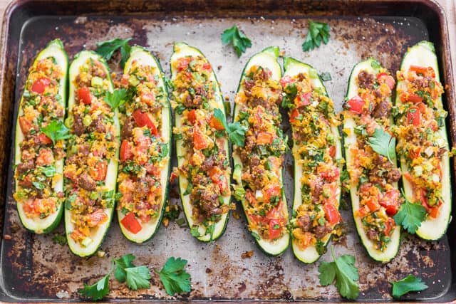 Sausage Stuffed Zucchini Boats - On a Sheet Pan with Parsley Garnish