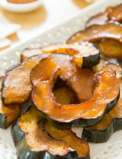 Roasted Acorn Squash - Presented on a Lacy White Platter on Wooden Board