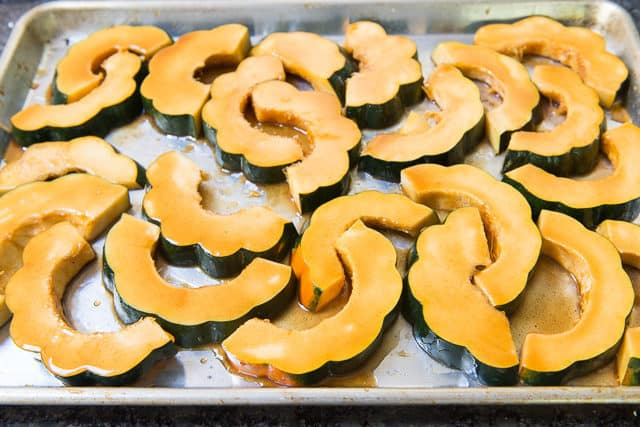 Acorn Squash Slices on a Sheet Pan Brushed with maple Butter