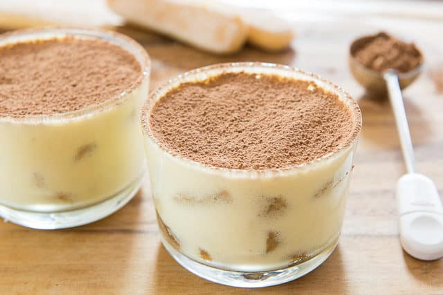 Authentic Italian Tiramisu In Individual Glass Ramekins With OXO Dusting Wand With Cocoa Powder