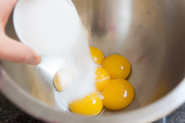 Adding Sugar To Egg Yolks For Tiramisu From Scratch