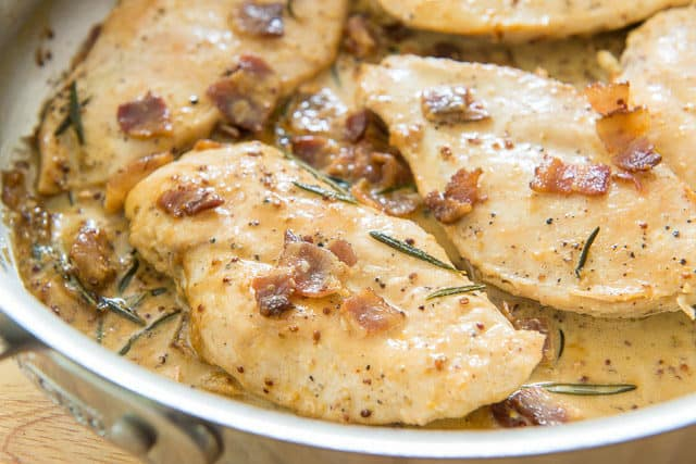 Chicken with Mustard Cream Sauce - In Skillet Topped with Bacon and Rosemary