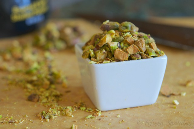 chopped pistachios in white dish for watermelon goat cheese salad