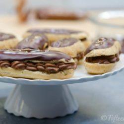 Chocolate Eclairs on White Platter