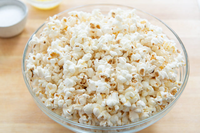 How to Make Popcorn on the Stove - A tutorial with end product shown in glass bowl