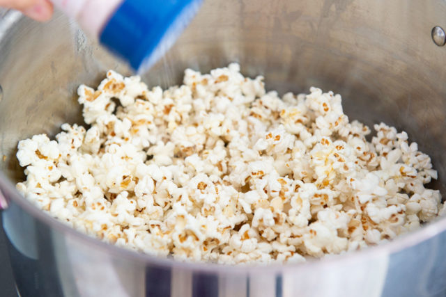 Sprinkling Salt over Stovetop Popcorn Recipe