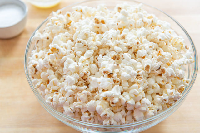 How to Cook Popcorn on the Stove - Shown in Glass Bowl