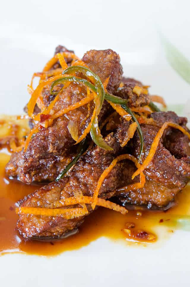 Orange Beef - On a Green and White Platter with Orange Rind Strips