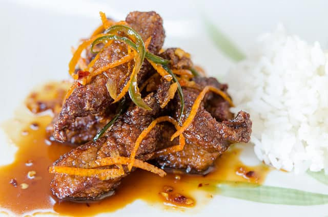 Orange Beef Recipe - Served On a Green and White Platter with Orange Rind Strips